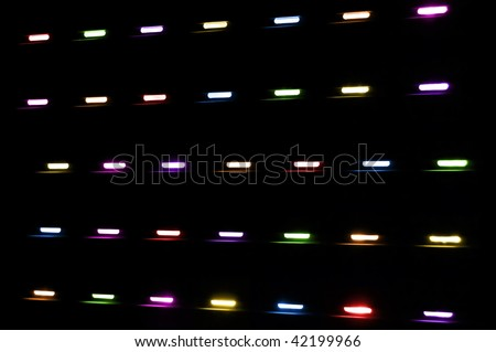 Colored lights shining through a window shutter. Abstract background. - stock photo