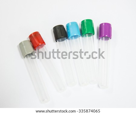 Colored liquids in six test tubes isolated over white background