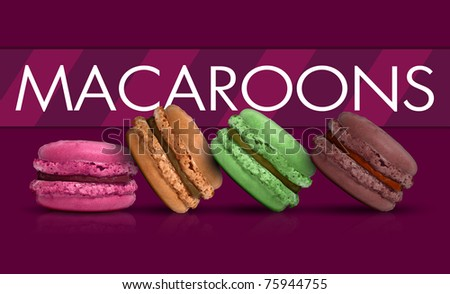 Colored macaroons on purple background - stock photo