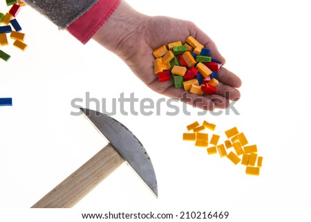 Colored mosaic tiles hand and hammer - stock photo