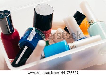 colored nail polish on a white background. - stock photo