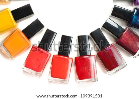Colored nail polish packed in a semicircle on a white background - stock photo