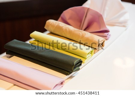 Colored napkins lie on the white board
