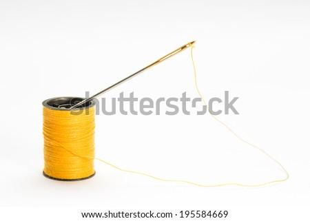 colored orange spool of cotton - stock photo