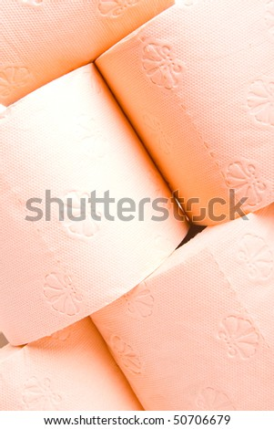 Colored orange toilet paper isolated on white background. - stock photo