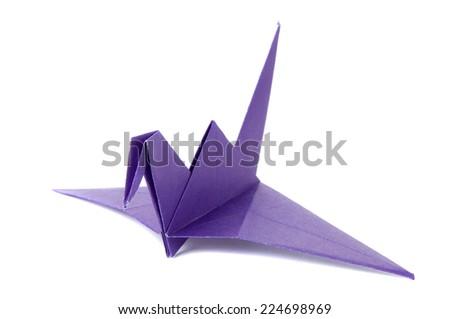 Colored origami crane isolated on white background - stock photo