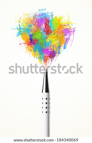 Colored paint splashes coming out of pen - stock photo