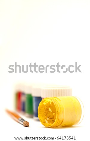 Colored paints on a white background - stock photo