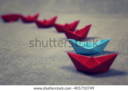 colored paper boats - stock photo