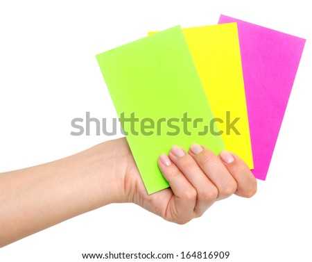 colored paper cards in hand isolated on white