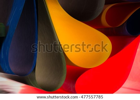 Colored paper in different shapes.