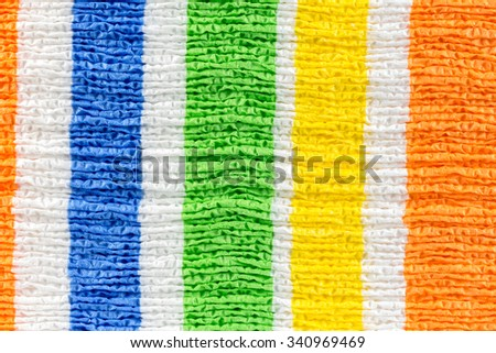 colored paper napkins in the background stacked - stock photo