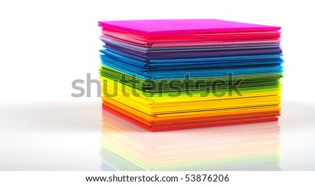Colored paper stack isolated on white background - stock photo