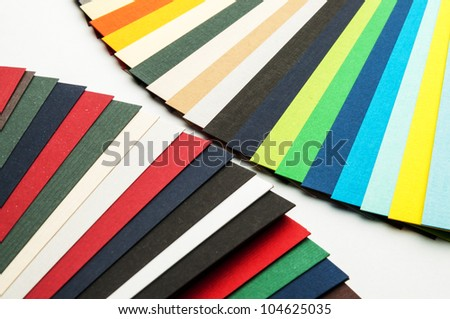 Colored paper strips laid out like a fan. - stock photo