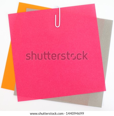 Colored papers  with staple - stock photo
