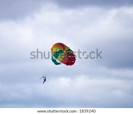 colored parachute in flight - stock photo