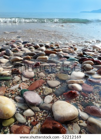 colored pebbles on the beach - stock photo