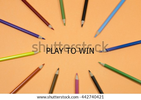 Colored Pen written showing to center with a word play to win.colored crayons - stock photo