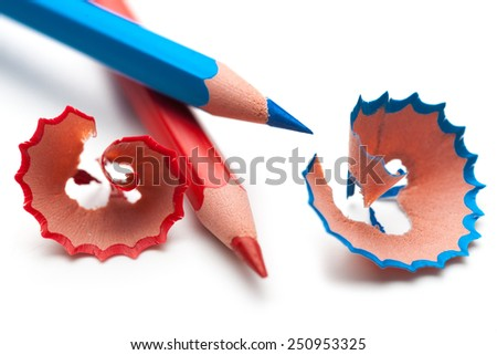 Colored pencil and shavings a on a white - stock photo