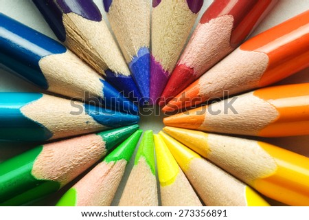 colored pencil in circle - stock photo