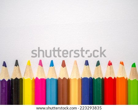 Colored pencil isolated on grey textured art paper