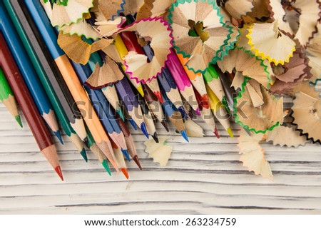 Colored pencil on wood background - stock photo