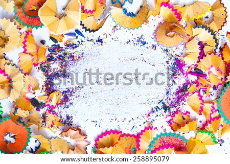 colored pencil shavings with copy-space - stock photo