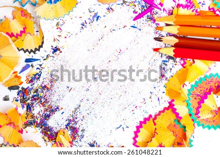 colored pencil shavings with copy-space. close up - stock photo