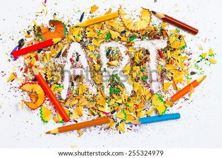 colored pencils and inscription art on multicolored chips - stock photo