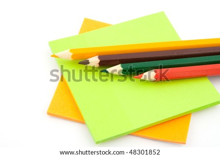 colored pencils and stickers  isolated on white background