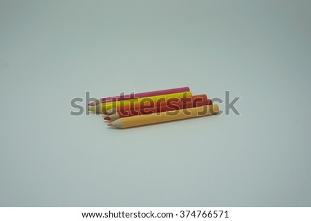 Colored pencils are a pattern on fabric - stock photo