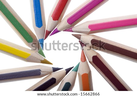 Colored Pencils arranged to form a white copyspace circle - stock photo