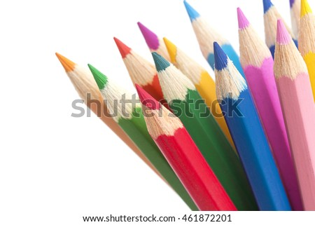 Colored pencils close-up isolated on white background