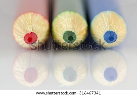 Colored pencils close up - RGB pencils close up front view - Red Green Blue pencils macro shot - stock photo