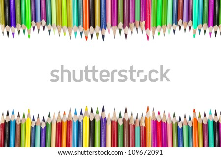 Colored pencils forming a border with copy space. shot in studio - stock photo