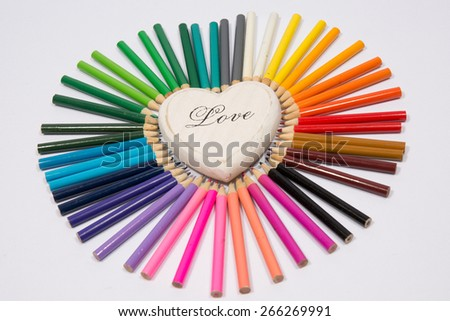 Colored pencils frame heart shaped - stock photo