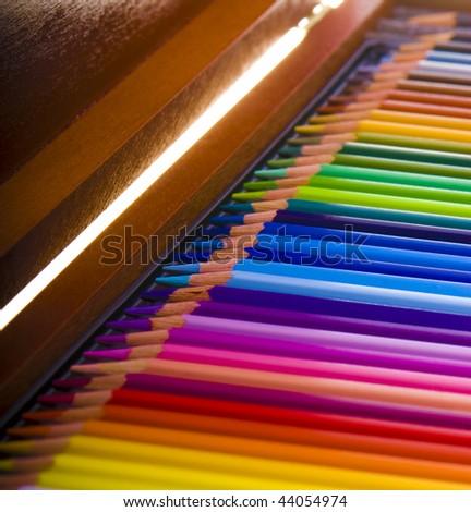 colored pencils in a box - stock photo