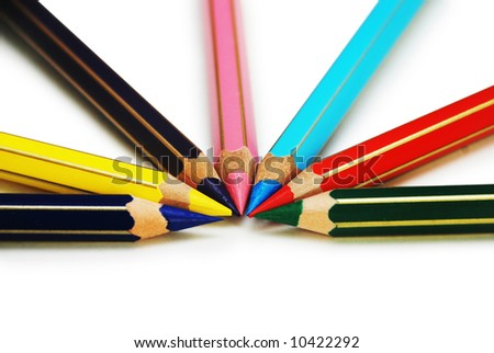 Colored pencils in circle order isolated on white - stock photo