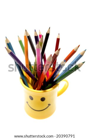 Colored pencils in mug - stock photo