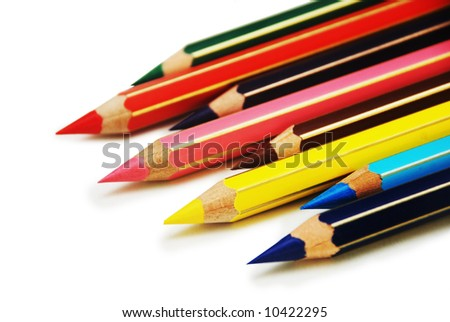 Colored pencils in order isolated on white - stock photo