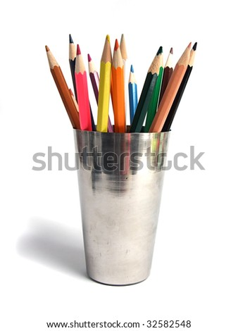 Colored pencils in steel cup - stock photo
