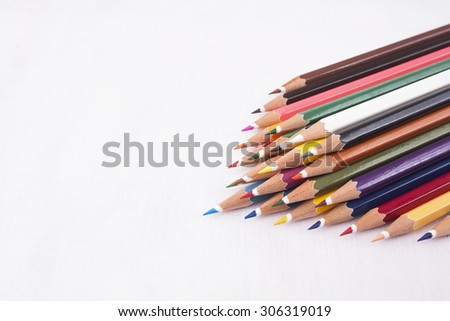 Colored pencils isolated on pure white background