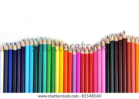 Colored pencils lined up in  row - stock photo