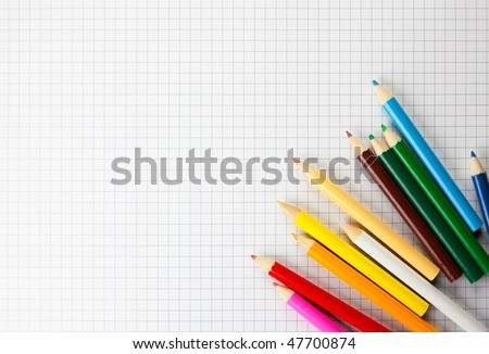 Colored pencils on a plotting paper - stock photo