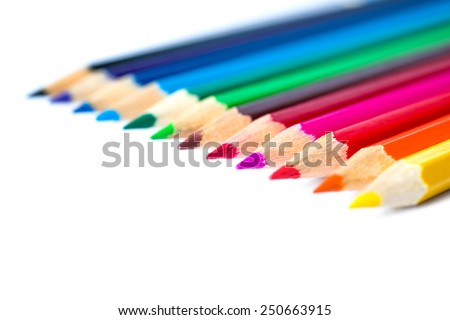 Colored pencils on an isolated background. Focus on the red pencil - stock photo