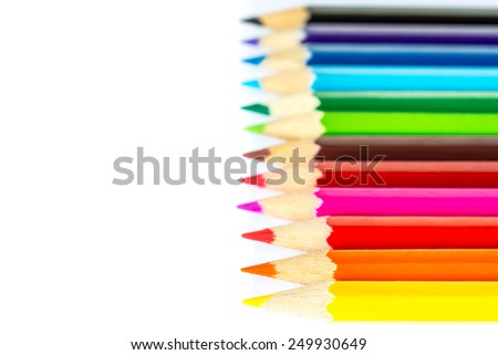 Colored pencils on an isolated background. Focus on the yellow pencil - stock photo