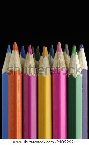Colored Pencils on Black Background - stock photo