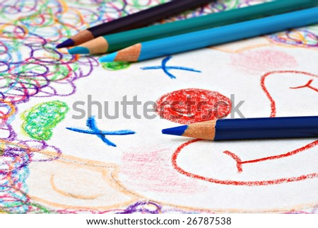 Colored pencils with fun, colorful sketch of a smiling clown.  Macro with shallow dof. - stock photo