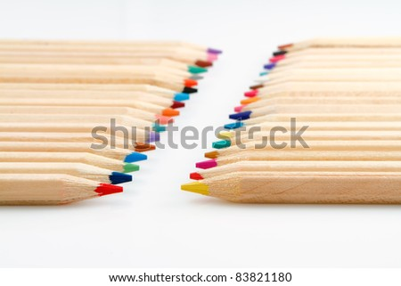 Colored pencils with gray background, focus to the tips of front pencils - stock photo