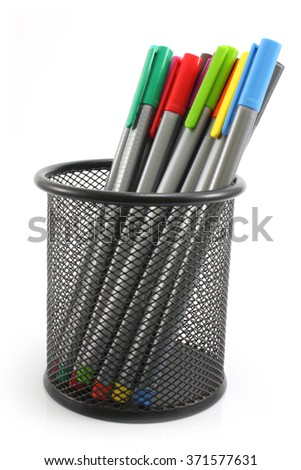 colored Pens  in iron basket on the white background - stock photo